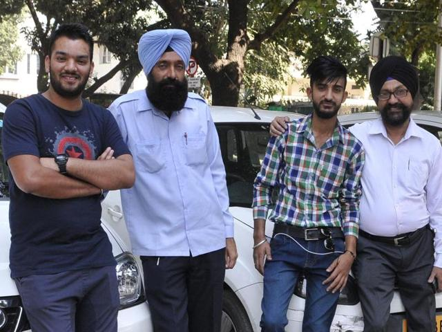 From Left—Taxi drivers,Arshdeep Gill, Mandeep Singh Jasveer Singh and Rajinder Pal Singh in Chandigarh on Wednesday.