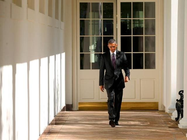US President Barack Obama walks the Colonnade toward the Oval Office of the White House in Washington on election day.
