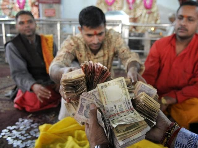 Meanwhile, at Sanatan Dharma Temple in Sector 19, Noida, the temple priests were anxious to know how many high denomination notes their donation box contained.
