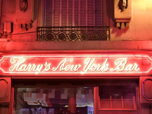 People stand outside the Harry's New York Bar in Paris.