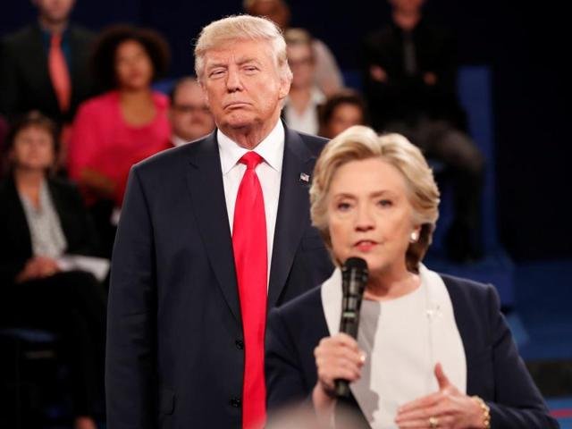 File photo of Republican US presidential nominee Donald Trump listens as Democratic nominee Hillary Clinton answers a question from the audience during their presidential town hall debate.