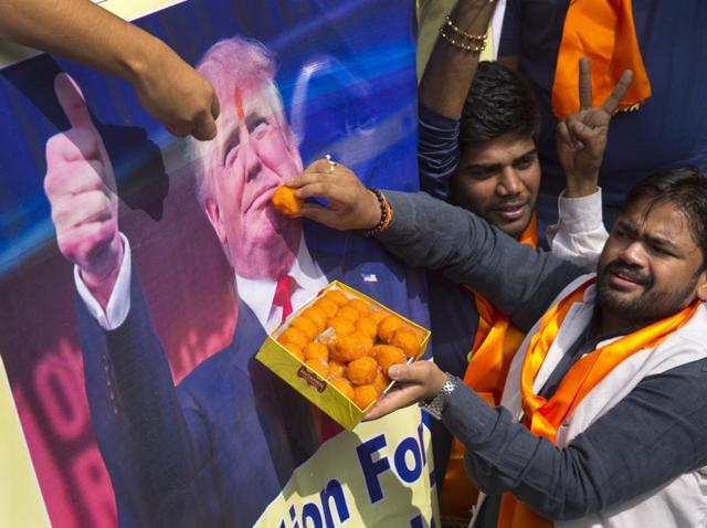 Activists belonging to 'Hindu Sena' offer sweets to US President-elect Donald Trump.