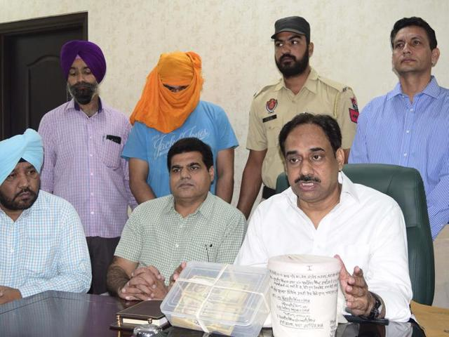 IG, counter intelligence, MF Farooqui addressing a press conference in Amritsar on Tuesday.