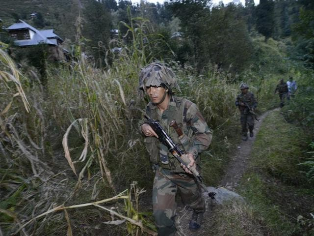 Indian Army soldiers move to a forward post on the LOC.