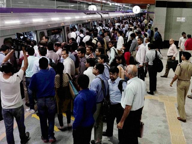 Commuters boarding a metro train at ITO Station in New Delhi.