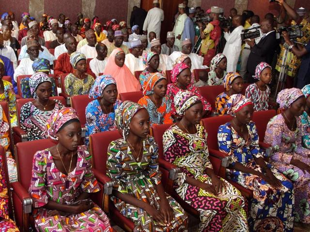 The 21 Chibok girls who were released by Boko Haram last week attend a meeting with the Nigerian President at the State House in Abuja, Nigeria.