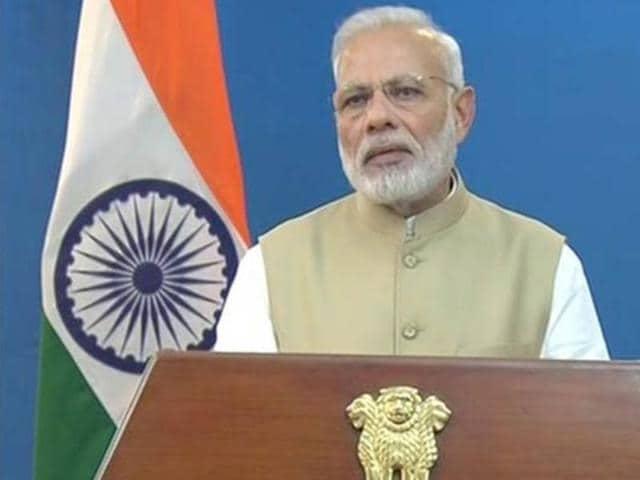 People take selfies with Prime Minister Narendra Modi in New Delhi on November 3, 2016.