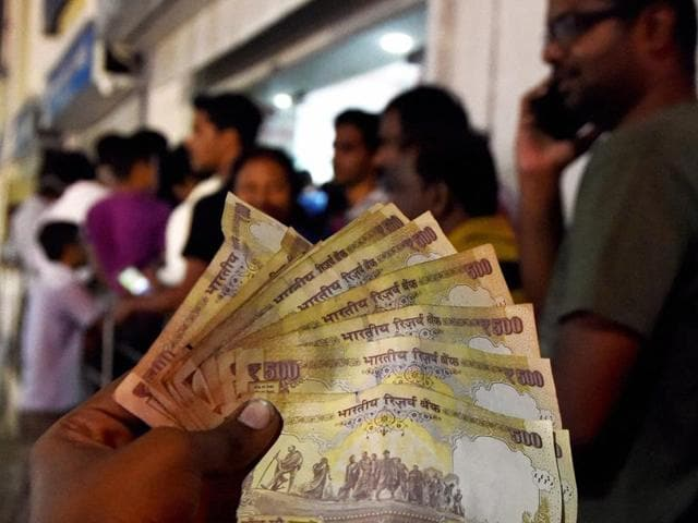 People lined up outside an ATM to withdraw 100 rupees notes and deposite 500 & 1000 rupees notes in Chennai on Tuesday.