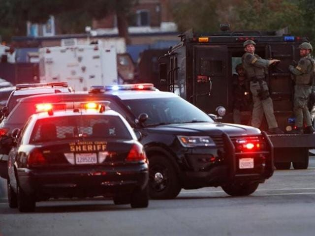 Police officers are seen at the scene of a shooting near a polling station, in Azusa, California.