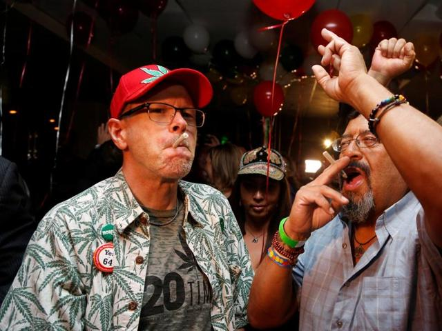 William Britt (left) and Al Moreno (right) celebrate after Californians voted to pass Prop 64, legalizing recreational use of marijuana in the state, in Los Angeles, California.