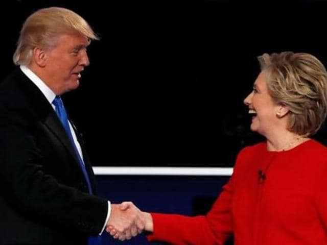 Donald Trump and Hillary Clinton shake hands at the end of their first presidential debate at Hofstra University in Hempstead, New York.
