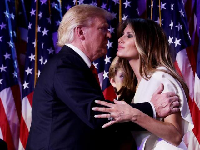 Republican president-elect Donald Trump embraces his wife Melania Trump during his election night event at the New York Hilton Midtown in the early morning hours of November 9.