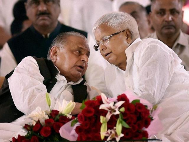 Samajawdi Party supremo Mulayam Singh Yadav with RJD chief Lalu Prasad Yadav during the Samajwadi Party's 25th foundation day celebrations in Lucknow on Saturday.
