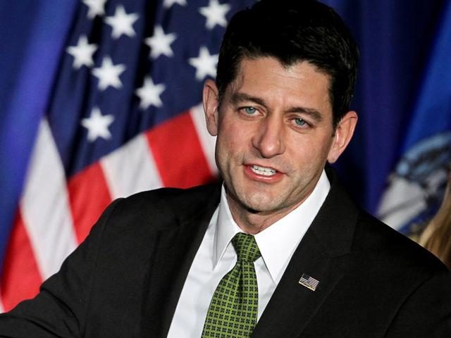 US speaker of the House Paul Ryan gestures to the crowd during an 'Election Night event' in Janesville, Wisconsin.