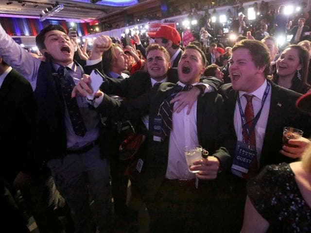 Supporters of US Republican presidential nominee Donald Trump react at his election night rally in Manhattan, New York.