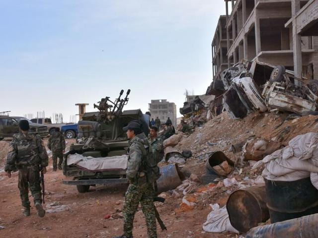 Syrian pro-government forces hold a position in Aleppo's 1070 district on November 8 after seizing it from rebel fighters.
