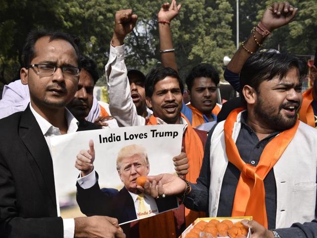 Hindu Sena activists celebrate Donald Trump's victory in US President elections at Janatar Mantar, New Delhi.