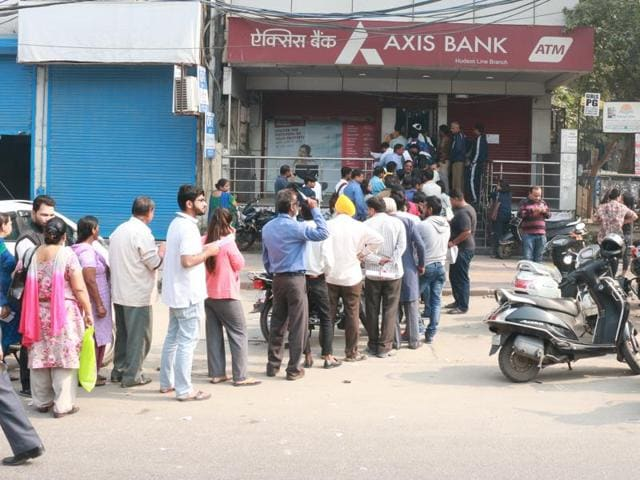 Watchmen are having a hard time dealing with students who queue up outside the ATMs and banks.