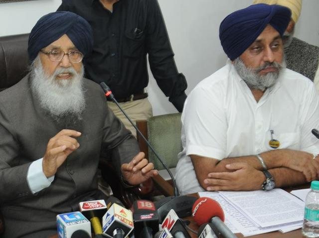 CM Badal and his deputy Sukhbir at a press conference in Chandigarh on Thursday.