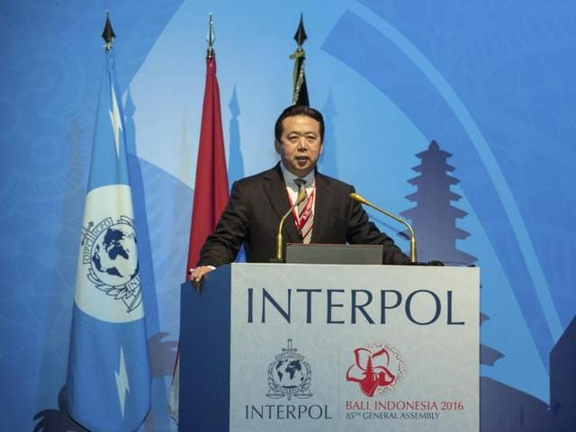 In this photo released by Xinhua News Agency, China's vice minister of Public Security Meng Hongwei delivers a campaign speech at the 85th session of the general assembly of the International Criminal Police Organization (Interpol), in Bali, Indonesia.
