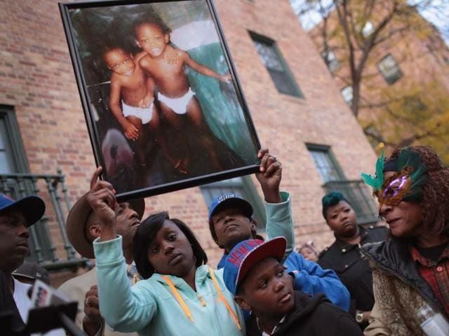 Friends and family members attend a memorial service for 17-year-old twin brothers Edward and Edwin Bryant who were shot and killed on October 31 in Chicago.