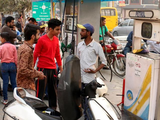 People with their vehicles at a fuel station in Bathinda on Wednesday.