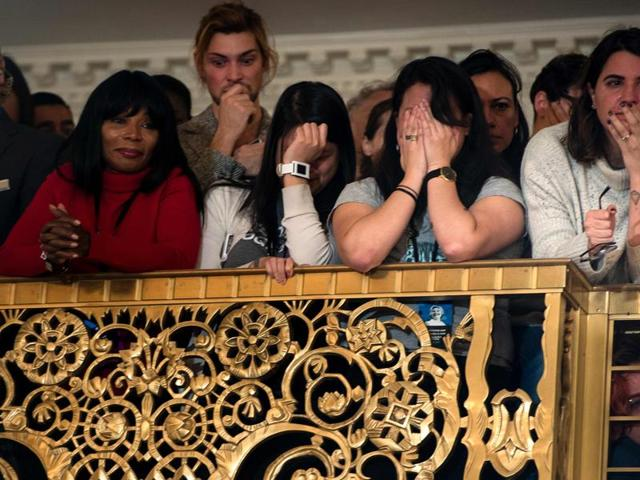 Staff and supporters listen as former Democratic US Presidential candidate Hillary Clinton speaks at the New Yorker Hotel after her defeat in the presidential election in New York.