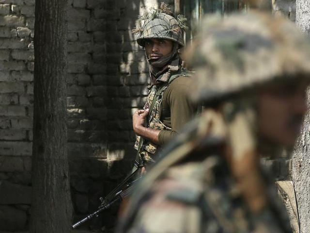 Indian army soldiers patrol near Nowgam sector, near the de facto border dividing Kashmir between India and Pakistan, in Indian controlled Kashmir.