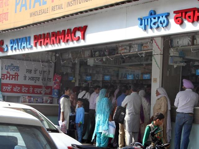 Rush of customers at a chemist shop outside Dayanand Medical College and Hospital in Ludhiana on Wednesday.