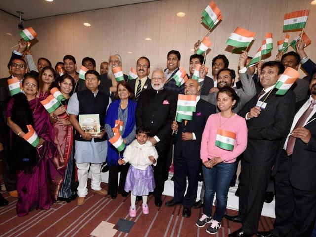 Prime Minister Narendra Modi meeting the Indian community at a hotel in Tokyo.