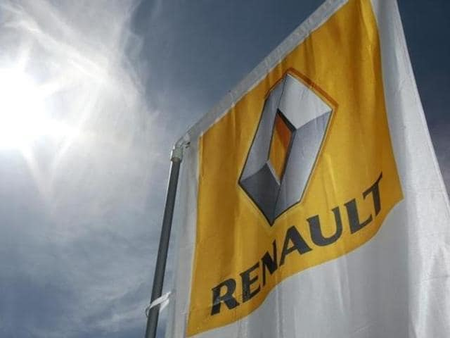 A Renault car company logo is seen outside an automobile dealership in Nice, France.