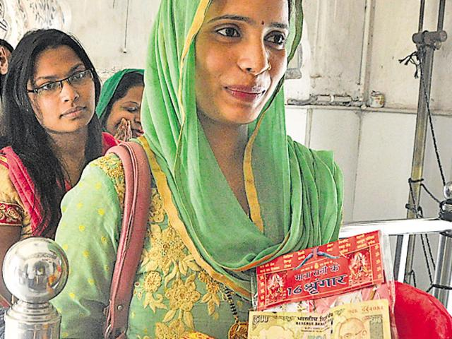 FOR GOD'S SAKE: A woman carrying a Rs 500 note in donation at the Mansa Devi temple in Panchkula on Wedensday.