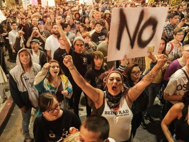 Demonstrators gather to protest a day after president-elect Donald Trump's victory, at a rally outside Los Angeles City Hall in Los Angeles.