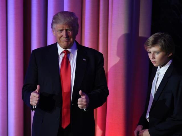 Donald Trump flanked by members of his family speaks to supporters during election night at the New York Hilton Midtown in New York on November 9, 2016.
