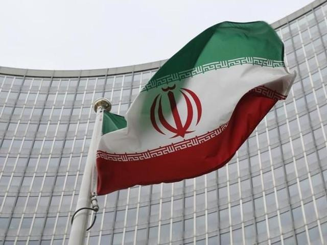 An Iranian flag flutters in front of the International Atomic Energy Agency (IAEA) headquarters in Vienna, Austria.
