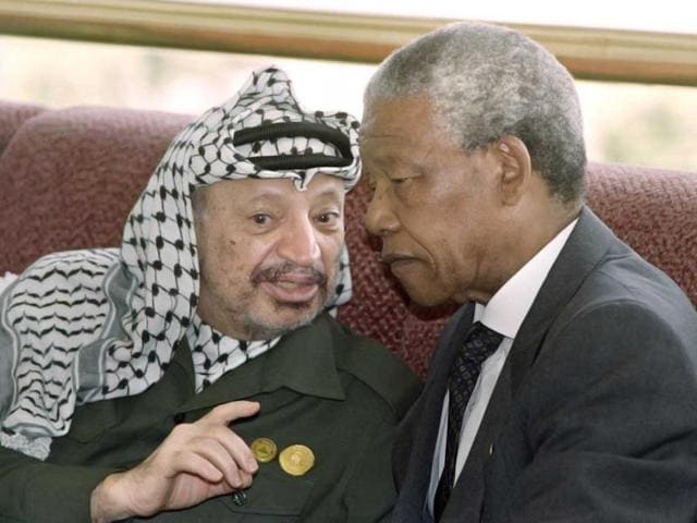 Yasser Arafat (R)  rose to become the leader of the Palestinian movement in the late 1960s, leading an armed struggle against Israel.