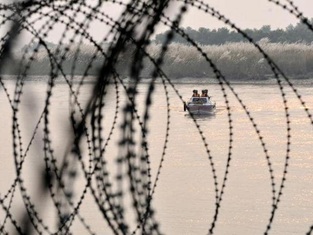 Indian Border Security Force soldiers patrol on a boat in Chenab along the Pargwal area of India-Pakistan international border in Akhnoor, about 70km from Jammu.