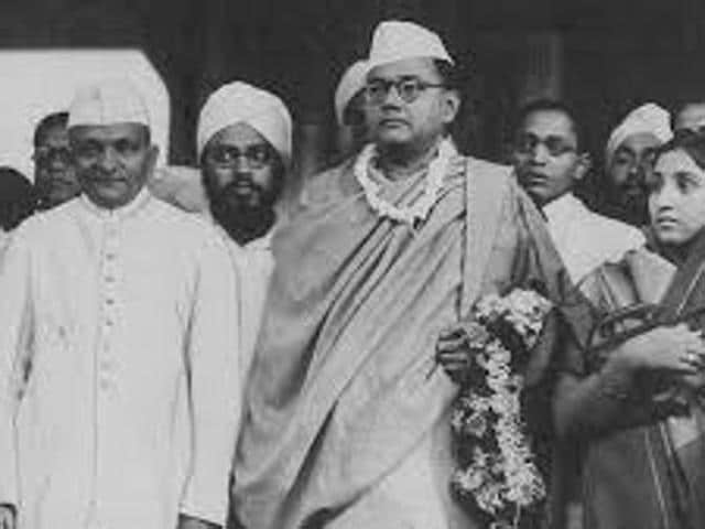 Chandra Kumar Bose (taking the flag from Amit Shah) joined BJPbefore the Bengal assembly elections.