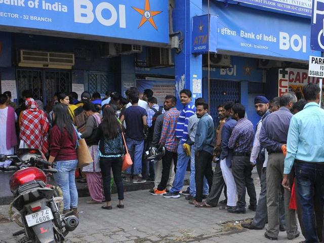 Heavy rush of people outside the BOI bank at Sector 32 in Chandigarh on Friday.