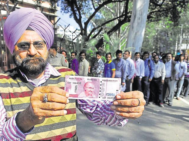 Long queues outside banks as the government demonetised Rs 500 and Rs 1000 currency in an effort to crack down on black money.
