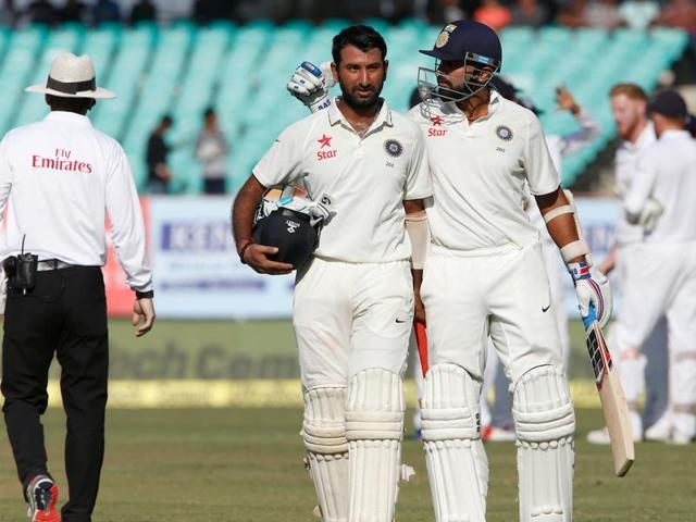 Murali Vijay and Cheteshwar Pujara's 209-run stand put India in the driver's seat in Rajkot against England.