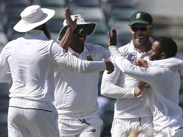 South Africa's Kagiso Rabada celebrates with team mates after dismissing Australia's Mitchell Starc.