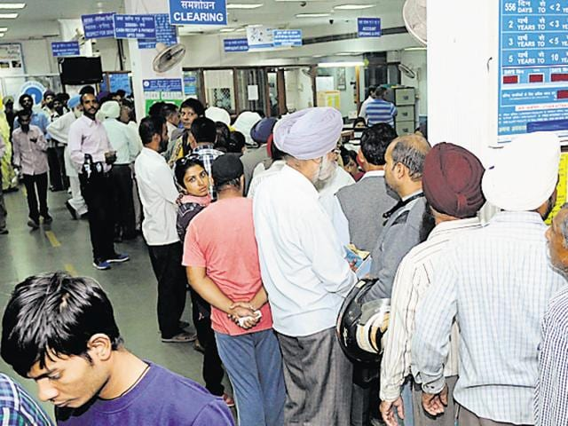 Customers at the Mall Road branch of State Bank of Patiala on Thursday.