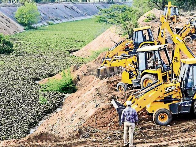 Farmers of Jhansla village in Patiala district levelling the SYL canal with the help of earthmoving machines in March this year, after the Punjab assembly passed a bill providing for transfer of proprietary rights to the original owners.