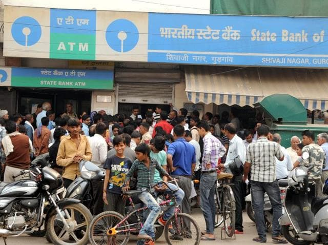 Public and private banks were swamped on Thursday with people looking to exchange Rs. 500 and Rs. 1,000 notes.