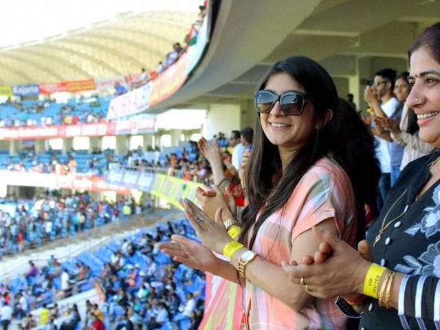 India batsman Cheteshwar Pujara's wife Puja  celebrates his ton in the stands.