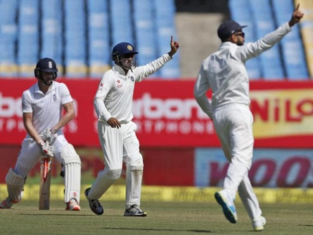 India's Mohammed Shami (2nd L) celebrates with his teammates after taking the wicket of England's Jonny Bairstow.