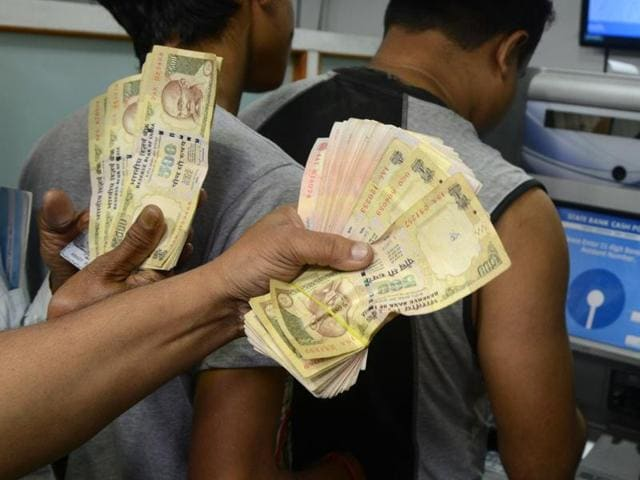 A man was arrested for trying to deposit Rs 25 lakh cash belonging to a Maoist guerilla in a bank, police said on Friday.