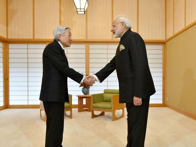 Emperor Akihito of Japan, left, shakes hands with PM Narendra Modi ahead of a meeting at The Imperial Palace in Tokyo.