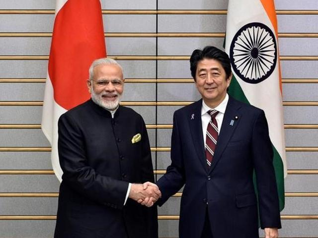 Indian Prime Minister Narendra Modi is shakes hands with Japan's Prime Minister Shinzo Abe at the start of their meeting at Abe's official residence in Tokyo, Japan.